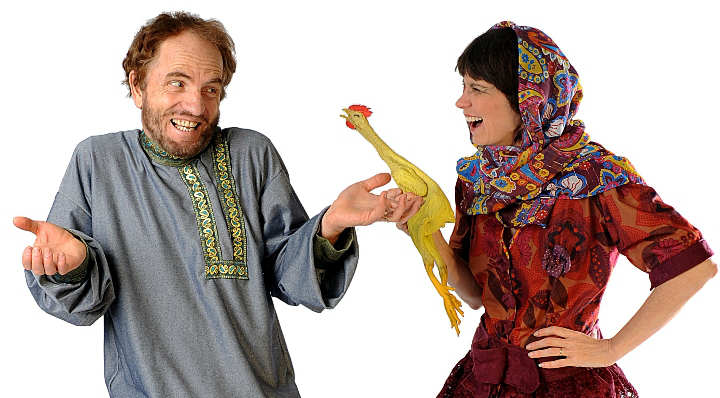 Simpe Ivan and his mother laugh over a rubber chicken