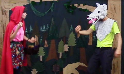The Wolf introduces himself to Red Riding Hood using American Sign Language